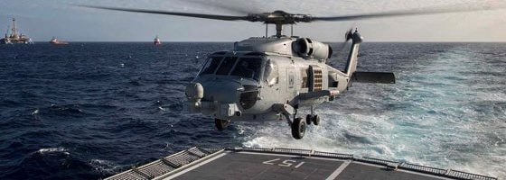 HMAS Perth's embarked MH60 Romeo helicopter prepares to conduct an air patrol